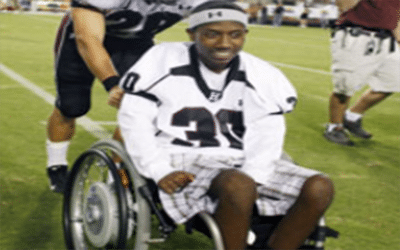 Paralyzed receiver is tackling life